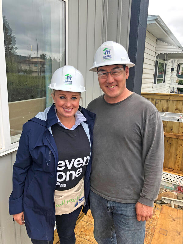 CREB Charitable Foundation's President Alyssa Campos with Habitat for Humanity's CEO Gerrad Oishi during a Build Day in Bowness