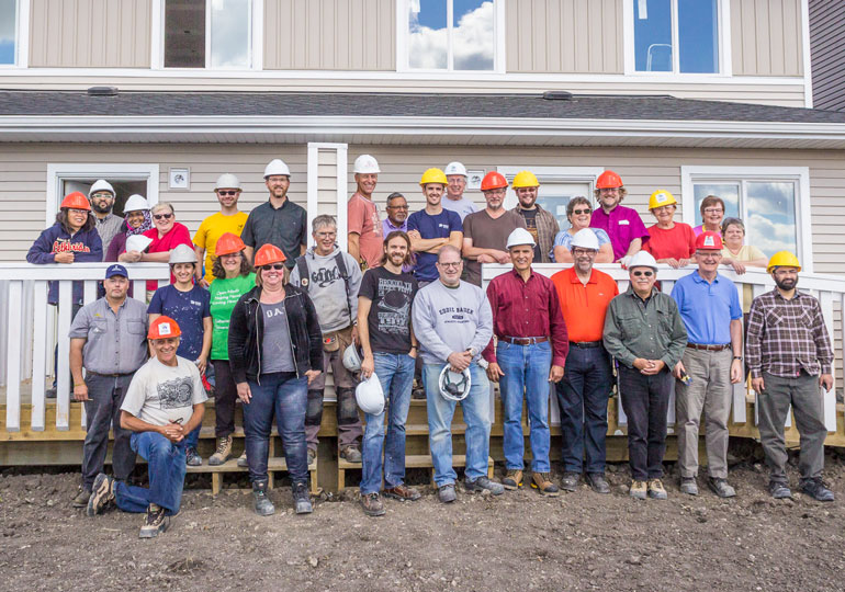 Interfaith Build Project Build Day in REdstone, Calgary