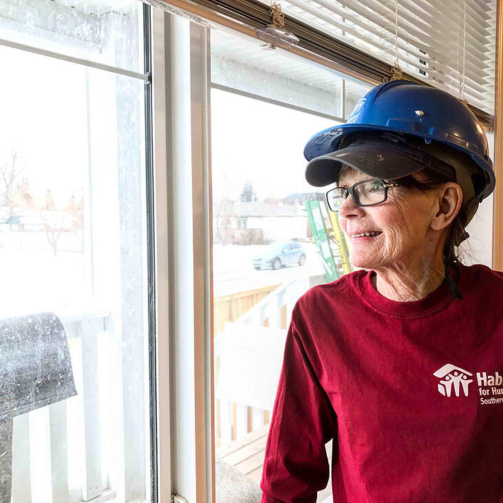 Peggy Bell inside a Habitat build