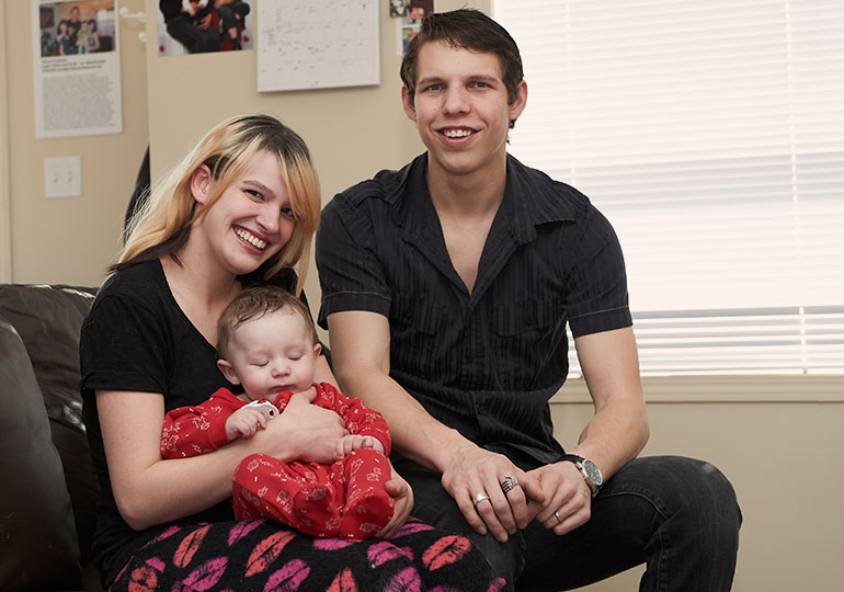 smiling family moving into their habitat home